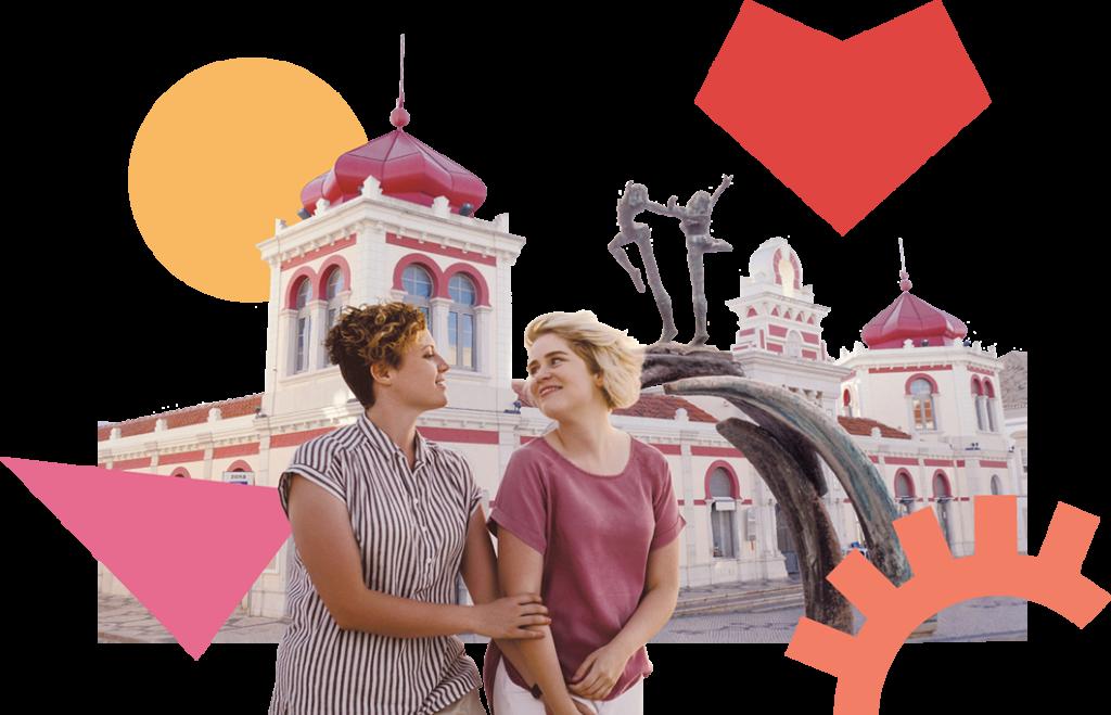 Two woman holding arms at Mercado de Loulé, Algarve