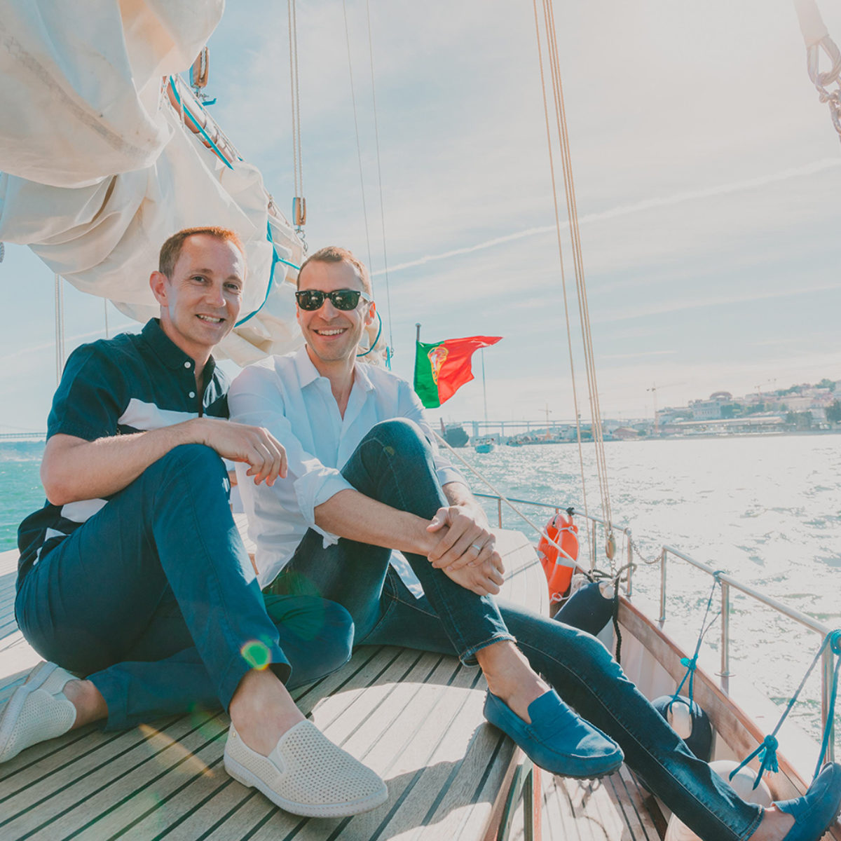 Gay couple on a boat at Tagus River, Lisbon, Portugal