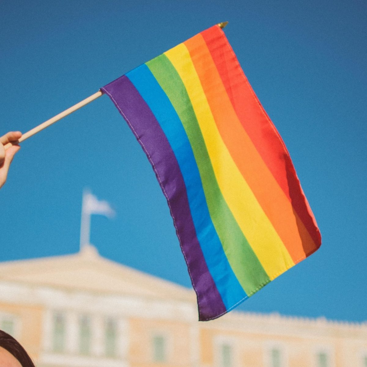 People holding rainbow flag in Lisbon, Portugal